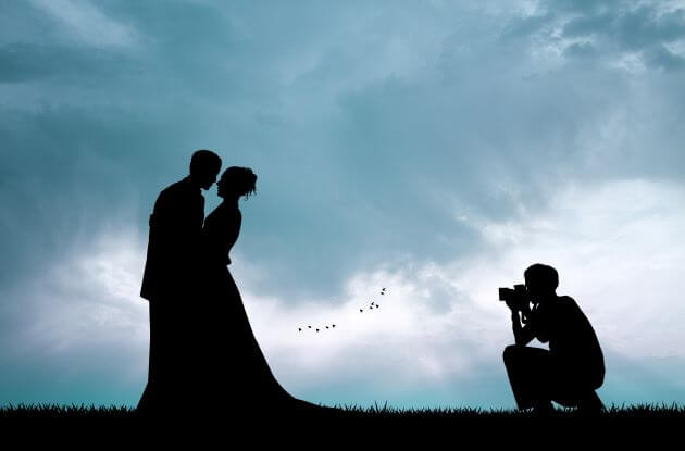 wedding photographer taking picture at dusk