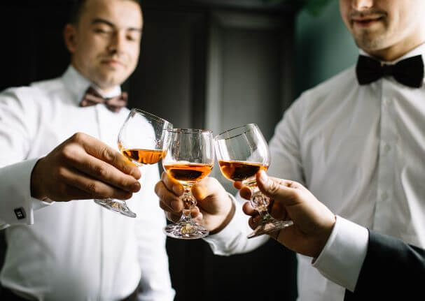 A groom toasts his Groomsman