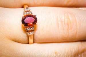 Gold ring with garnet