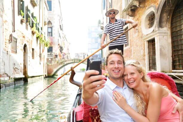 A couple on a gondala in Venice, Italy