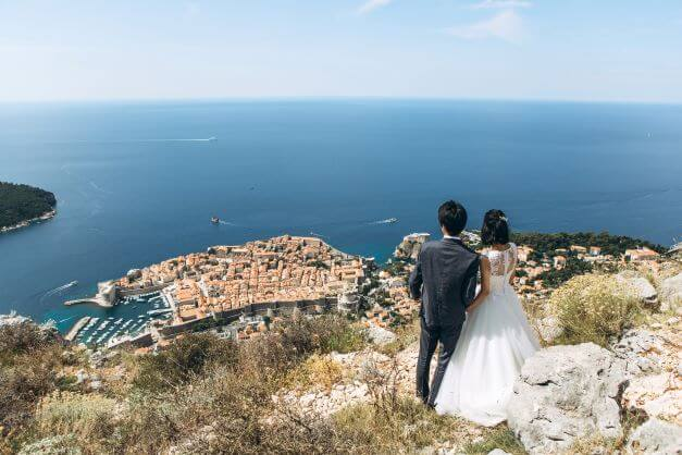 newly married couple overlooking Dubrovnik